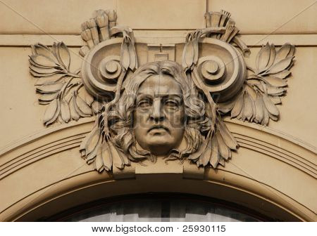 Allegory of art, a stucco mask on the facade of the Municipal House in Prague, Czech Republic