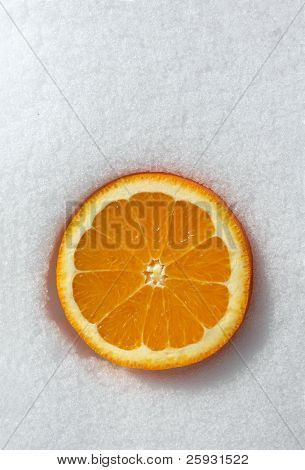 Orange on snow. Vitamins in the winter time