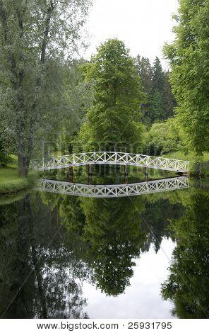 White Wooden Bridge in the park of the Mikhailovskoye Estate, Russia