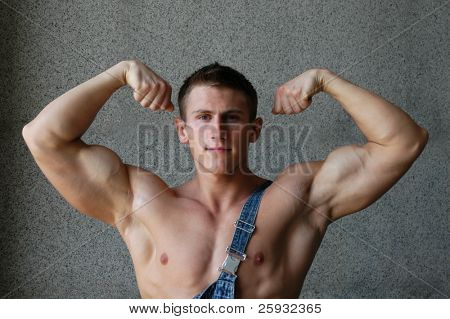 Muscular man showing his biceps