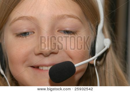 Young girl learning foreigner language with a headset and a microphone