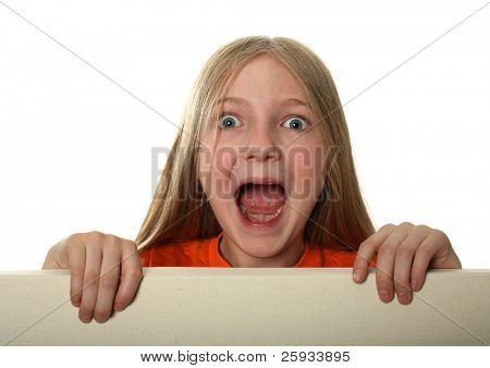 Crying blond girl peeping over a blank billboard isolated on white