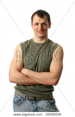 Young sexy man wearing a green muscle shirt isolated on white