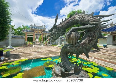Dragon Statue With Fountain In Pond