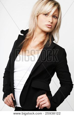 Blond businesswoman in black suit.