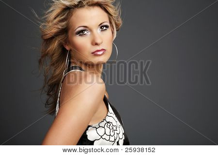 Beautiful young woman with hair on wind.