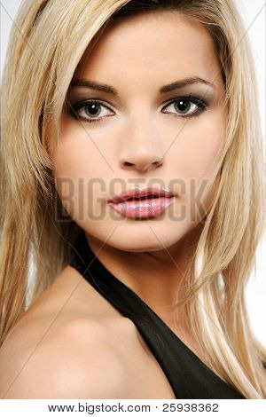 Young beautiful blond girl on white background.