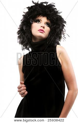Attractive young girl in black feathers on white background.
