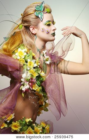 Gorgeous young woman wearing flower costume.