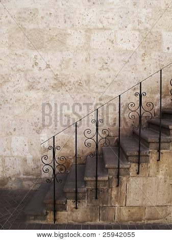 Old stone stairs with metal railings, Peru.