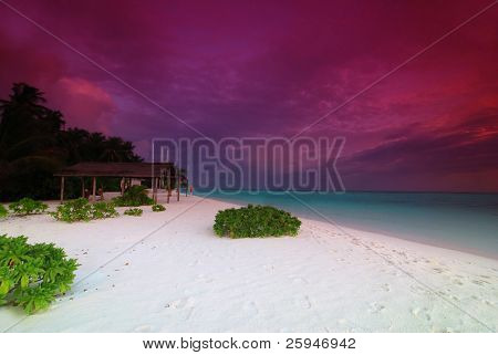 Beautiful tropical landscape with violet morning sky in the Maldives