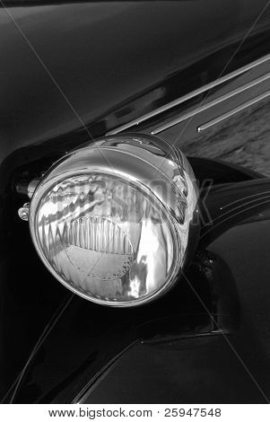 Detail of a vintage (1948) car light in black and white