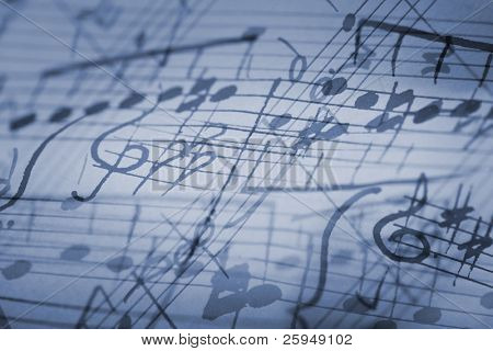 hand-written musical notation background.