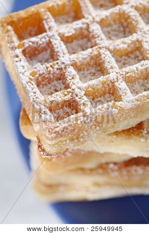 Waffles with powder sugar sprinkled on top