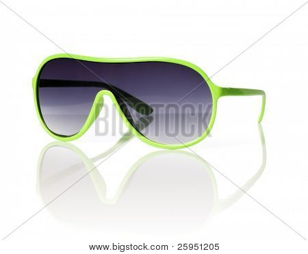 Cheap green plastic 1980s style sunglasses on reflective background.