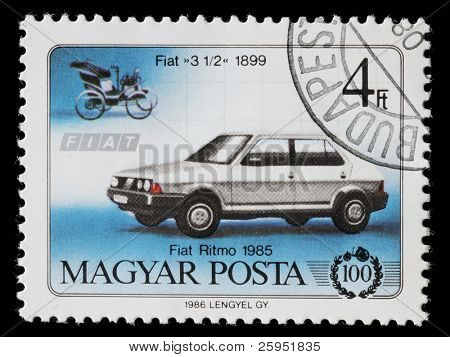 HUNGARY - CIRCA 1986: Hungarian commemorative stamp celebrating 100 years of the automobile. Fiat 3 1/2 and Fiat Ritmo. circa 1986
