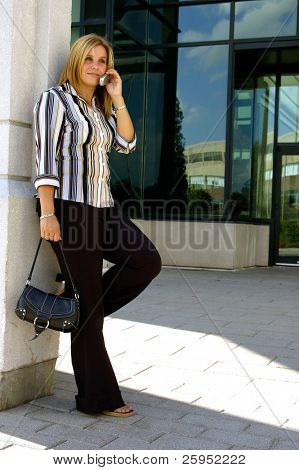 Attractive Blond Woman Standing  Outside Her Office