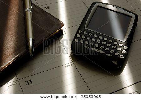Businessman's Planning Desktop With PDA, Horizontal Framing