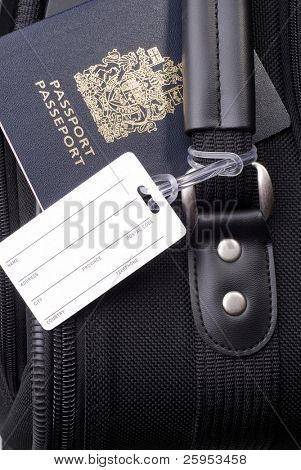 Black Suitcase With Blank Luggage Address Label And Canadian Passport
