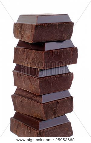 Stack Of Dark Chocolate Pieces, Isolated Over White