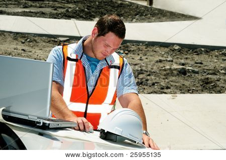 Road Engineer Checking Plans To A New Highway