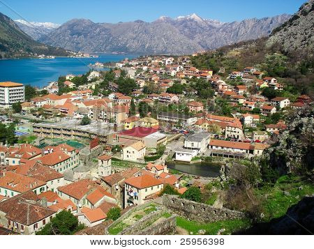 Panorama of Kotor bay and Kotor town in Montenegro. beautiful view with red roofs and blue water.