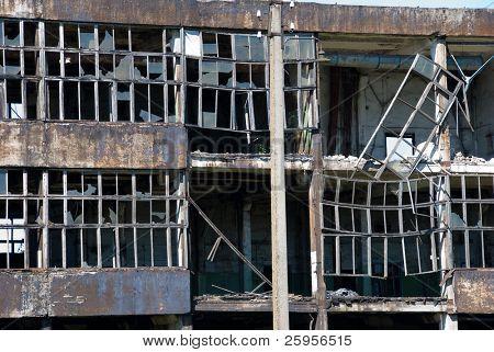 Broken windows in an abandoned building