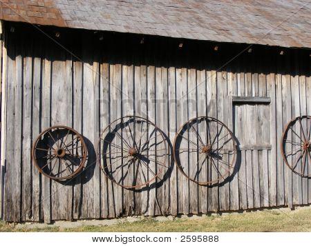 Wagon Wheels on an Old Barn