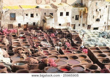 Leather should soak in color in Fez, Morocco, Africa. Tradition keeping in Fez attracts tourists and travelers