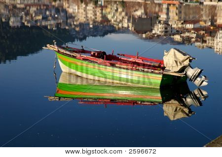 Colorful Fishing Boat On Lake