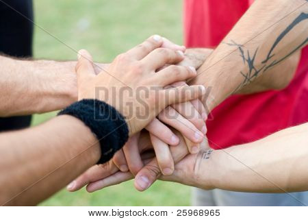 Sports hands of group of acrobats