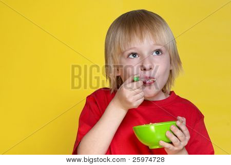 The nice boy with a bowl of corn-flakes