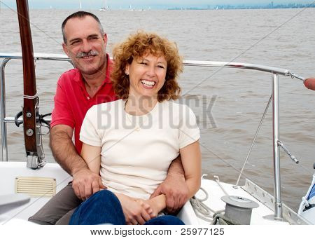 Elderly happy couple onboard the yacht