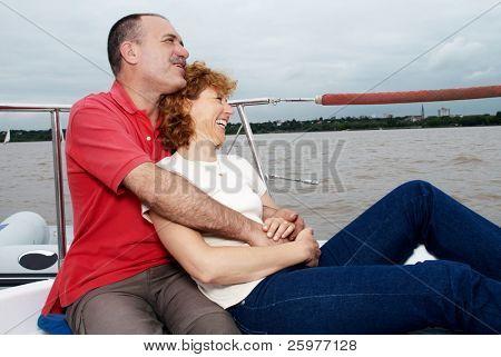 Elderly happy couple onboard the yacht