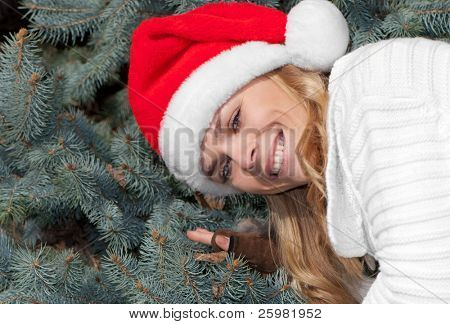 Portrait beauty girl in santa red cap