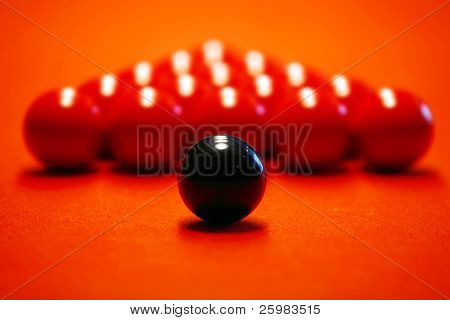 Billiard balls on a red cloth