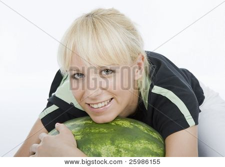 Beautiful young fruit-grower love to embrace water-melon