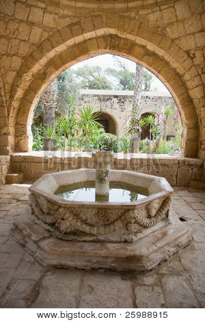 Fountain in front of an old house on Cyprus