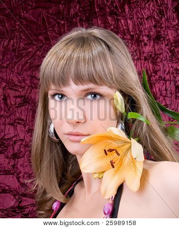 fashion woman portrait with a beautiful flower