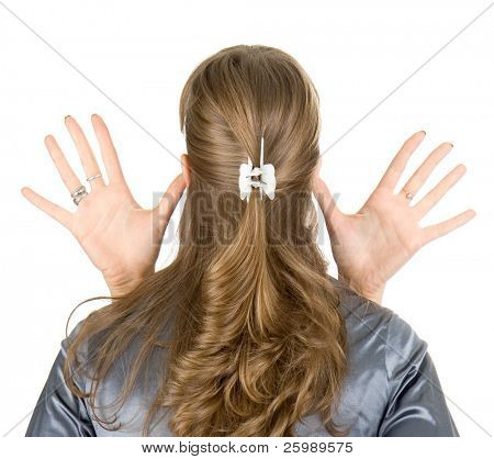 young woman showing a  sign with hands, isolated on white
