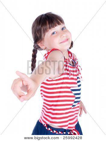 Cute little girl point her finger at someone, studio shot