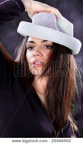 Beautiful fashion woman portrait with white hat, studio shot