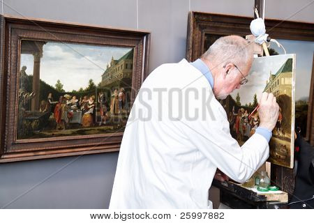 VIENNA, AUSTRIA - MAY 20: Man make duplicate of painting in Kunsthistorische museum on 20 May 2010 in Vienna, Austria