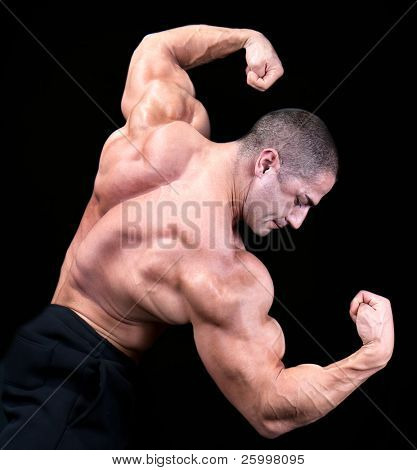 Back view of a body builder, isolated on black
