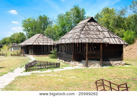 Traditional timber serbian houses with Wooden Roof and stone base. Velika Plana. Serbia. Eastern Europe