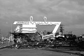 demolition of 1950's Drive In Diner Johnies Broiler in black and white