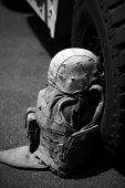 picture of humvee  - us military flack jacket and helmet lay against a h1 humvee - JPG