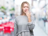 Young blonde woman over isolated background bored yawning tired covering mouth with hand. Restless a poster