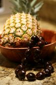 picture of kukui nut  - pineapple with a kukui nut lei in a bowl - JPG