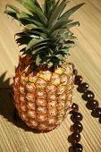 stock photo of kukui nut  - a fresh pineapple with a  - JPG